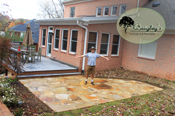 Dalton Quigley is standing on the patio he just made in Brentwood Tennessee. Get a patio built at your home by contacting us, we work all over Nashville, Franklin, Brentwood, Spring Hill, and Nolensville Tennessee.